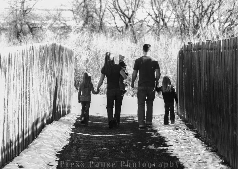 family walking, snow, light